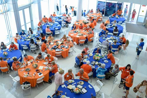 Alumni, faculty, staff and students celebrated the annual reunion tailgate reception at the George T. Harrell, M.D., Medical Education Building before the Gators took on the University of Kentucky WIldcats. The event featured a silent auction that raised money for the Alumni Council Book Awards.