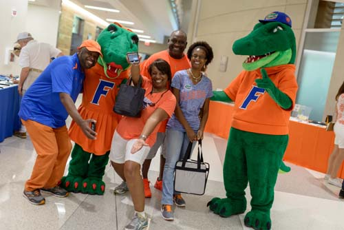 UF mascots Albert and Alberta had plenty of help from the UF College of Nursing family and alumni getting fired up for the Kentucky game.