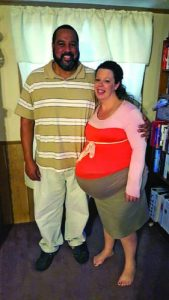 Pictured are Jackie and partner, Mark. Jackie worked until just days before her delivery.